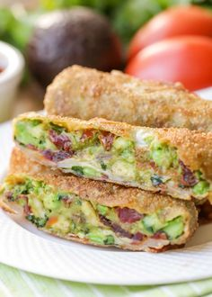 These Cheesecake Factory Avocado Egg Rolls are a delicious copycat recipe of this yummy restaurant appetizer that everyone loves! Filled with avocados and sun-dried tomatoes and served with an amazing dipping sauce. Best Appetizer Recipes, Yummy Appetizers, Party Recipes, Yummy Recipes, Asian Appetizers, Mexican Recipes, Party Snacks, Egg Roll Recipes, Avocado Recipes