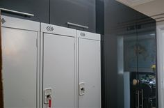 After photo of the locker corridor. Graphite gloss larder unit and wall cabinets for hidden away storage