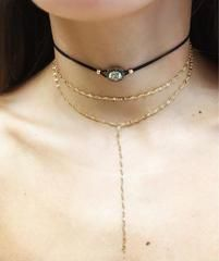 Simple and delicate, this faux leather draw string necklace features a center stone adornment. Extremely adjustable--drawstring feature allows you to make this necklace as small as needed. About Gina