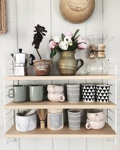 Loving the grey and pink colour theme. The jug of flowers make this shelfie a pretty perfect one!