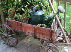 Old Red Wagon...filled with blue zinc watering can & vines.