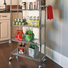 """An Organizer's dream. 6 Shelf Pantry Rack - Improvements. Perfect for small spaces, needs just 10"""" x 24"""". This pantry caddy has six adjustable shelves with side rails to prevent items from falling off as it's being rolled, and four clip-on dividers to keep cereal boxes or cookbooks in place. Shelf height adjustable in 1"""" increments, all without tools. Comes in 4 colors. $100."""