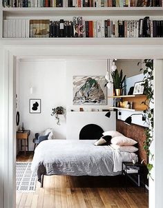 A bedroom with book shelves over the door in the home of artist Kate Tucker. Photo - Sharyn Cairns.