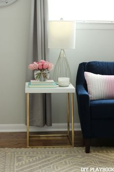"""Bridget from DIY Playbook painted this $5 thrifted table Sherwin Williams """"Pure White"""" by HGTV Home and we're loving the look! Such a simple update to this side table."""