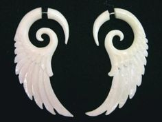 Amazon.com: Wing Style Carved Bone Earrings Tribal Split Expander Spiral Angel Wings Jewelr: Clothing