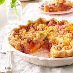 Juicy Peach & Strawberry Crumb Pie Recipe -You've had peach pie and strawberry pie, and maybe even peach-strawberry pie. But throw in some garden-fresh basil and you're in for a real treat. Trust me. —Lindsay Sprunk, Noblesville, Indiana