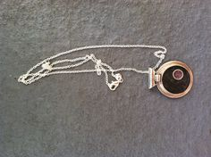 Sterling silver pendant with black and purple concrete inlay.