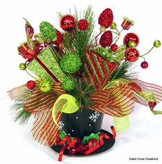 Top Hat Centerpiece Floral Arrangement Christmas Holiday red lime green Whimsical FUN Wedding reception design by Cabin Cove Creations by cabincovecreations on Etsy https://www.etsy.com/listing/200658807/top-hat-centerpiece-floral-arrangement