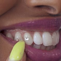Tooth gems are the method of the moment when it comes to blinging out your look. Musicians like Flavor Flav, Drake, and Hailey Bieber have all been seen with tooth gems. We visited Dr. Bobbi Peterson to see how she gives her clients the look. Grillz, Gems Jewelry, Body Jewelry, Tooth Jewelry, Dental Jewelry, Jewellery, Peircings, Ear Piercings, Diamond Teeth