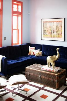 swanky navy sofa...loving the tangerine touches in the room too.