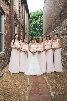 Bride and bridesmaids. Flowers by Regalo Design.
