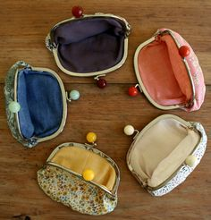 Lovely Liberty Coin Purses >> by the purl bee >> This has a link to buy a kit, but it also has a tutorial to show you how to make one for yourself!