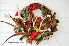 Bring in the holidays  Old World Style  with this festive holiday Wildlife wreath . Red dogwood branches wind around a real 6 point Elk