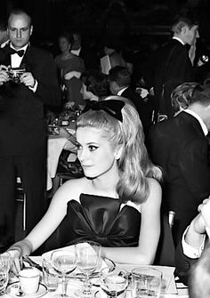 Catherine Deneuve at a party in Paris, 1962.