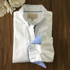 Banana Republic Oxford shirt Soft, comfortable fit, Oxford shirt in white, with contrasting blue detail on inner cuff and and blue and white striped ribbon detail running down the front. Perfect condition, worn once. Banana Republic Tops Button Down Shirts