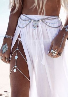 Amp up your swimwear game with this silver boho layered belly chain.