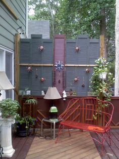 $2 garage sale shutters add privacy and personality to a deck.