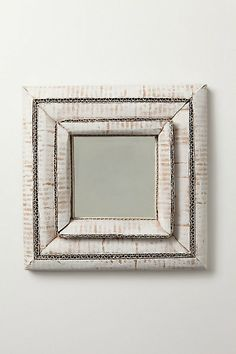 Noelle Rigaudie bent, folded and shaped pieces of cardboard hand to create this mirror's one of a kind frame.