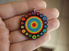 Quilled tight coil standard rainbow pendant, circular style. July 2014.