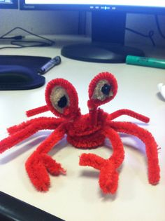 Pipe cleaner crab.   Could use googly eyes also.