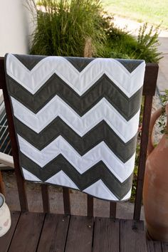 LOVE!! it to hang over my couch and to cuddle up with!! chevron quilt