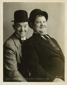 Stan Laurel and Oliver Hardy better known as the comedy duo of Laurel and Hardy.
