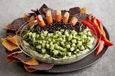 Add an upgrade to your Halloween appetizer menu with our Creepy Halloween Pesto Dip. This Halloween pesto dip is sure to delight (and not be a fright!) at any Halloween party! Entree Halloween, Halloween Appetizers, Halloween Party, Halloween Ideas, Family Halloween, Holidays Halloween, Halloween Costumes, Basil Pesto Sauce, Pesto Dip