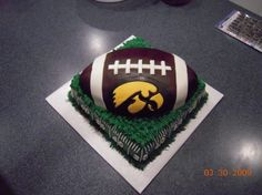 Iowa Hawkeyes Football Cake This cake was made with MMF on the field and Chocolate Fondant on the football. My second football cake. 10th Birthday, Birthday Parties, Birthday Ideas, Iowa Hawkeye Basketball, Iowa Hawkeyes, Chocolate Fondant, Bar Mitzvah, Food Art, Birthdays