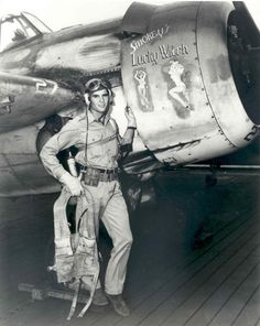 "Ensign ""Smoke"" Bennett, fighter pilot assigned to escort carrier Gambier Bay; notice rare Nose art (art was rare on Navy planes)"