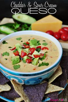 Cheddar and Sour Cream Queso ~ instead of processed cheese, this creamy dip boasts loads of flavor from all natural ingredients, including garlic, jalapenos, tomatoes, cilantro, and avocado   {Five Heart Home}