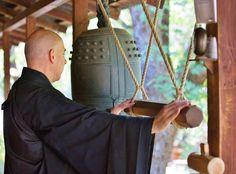 Monk David Zimmerman rings the densho bell to signal the beginning of practice at the Tassajara zendo, or meditation hall.