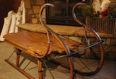 """Sleigh Coffee Table – Eagle Head Portland Cutter Sleigh New 21st century Wood, Metal 64""""l x 26""""w x 37""""d © Vintage Winter The sleigh coffee table is a beautiful replica of a 19th Century horse drawn cu"""