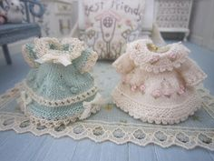very nicely done knitted miniature dresses.   I would like to be able to make these