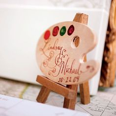 Brides Magazine: Lindsay & Michael in Tuscany - As a tribute to Michelangelo, the couple used an artist's palette as their wedding sign.