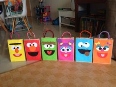 Sesame Street Party gift bags for the kids. I hand made 24 bags of 6 different characters. It was terribly tedious but so worth it.  I bought plain brown bags from daiso (it costs $2 for 25 pieces), I taped those tube fuzzy handles on the inside of the bag and used construction paper to cut out the faces of the characters.