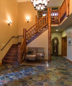 Grand entryway with log railings at Meadowbrook Circle, Steamboat Springs, CO. #steamboat #steamboatspringsrealestate #skitown #mountainliving