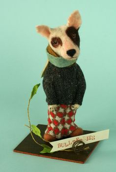 dog in checked pants and sweater