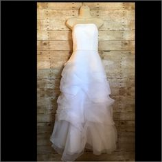 Shop Women's David's Bridal White Silver size 8 Wedding at a discounted price at Poshmark. Description: David's Bridal Strapless Wedding Dress Size 8 - Excellent Condition, has been cleaned, NO RIPS NO STAINS, The back zips up. White dress with silver diamond like beading around waist. Nude Bra padding has been sewn in. ......Measurements // Bust 38' Waist 30' Length (from Top point to bottom point) 52' Hip 50' ..... Material // SHELL 100% polye...