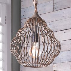"""Old Fashioned Beehive Style Pendant  A charming rendition of the classic beehive shape comes to light in this vintage style pendant. The iron frame is scuffed with a rough mocha finish with flakes of underlying gold leaf shining through. The vintage look is completed with tan cloth wire. Hang one pendant for a modest cottage chic look or group several together for a more lavish mod style. 60 watt medium base lamps max. (13.5""""Hx10.9""""W)"""