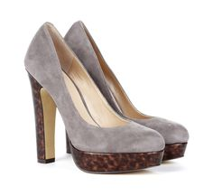 Genuine suede pump with a tortoise heel and platform detail.