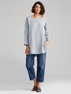 Boxy, slightly oversized fit. Measures 33 inches in front, 35 inches in back (size small). Model featured is 5'11