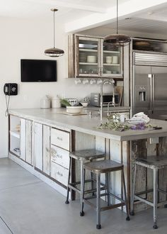 Amanda Pays Concrete Kitchen Counter, just right combo of reusable materials and stainless appliances. Just needs a little color, maybe.