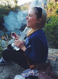 haha ignoring the bong, there's just something really great about the vibe in this picture and the soft lighting, how genuinely happy her face is, the pretty mountains in the distance i just LOVE IT