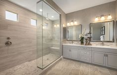 Soft-hued gray walls and tile help evoke a bright, airy feel in this master bathroom. | Pulte Homes