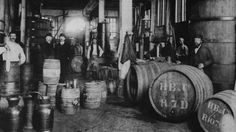 Workers pose for a photo at the Hoboken de Bie & Co. gin distillery in Rotterdam, Netherlands, c1900