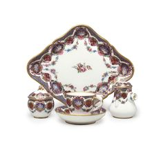 A SEVRES PORCELAIN FRISES RICHES SOLITAIRE (DEJEUNER 'LOSANGE') | BLUE INTERLACED L'S ENCLOSING DATE LETTER K FOR 1763 AND PAINTER'S MARK FOR MEREAUD TO EACH, INCISED FR TO THE CUP AND T TO THE SUGAR-BOWL | All other categories of objects, decorative tableware & centre pieces | Christie's