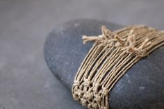 twine-wrapped stone - by Gennine Zlatkis Stone Crafts, Rock Crafts, Arts And Crafts, Zen Rock, Rock Art, Wood Stone, Stone Art, Stone Wrapping, Sticks And Stones