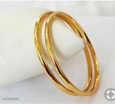 Bangles & Bracelets Radha exclusieve 1 GM Gold women brass bangles Base Metal: Alloy Plating: Gold Plated Sizing: Non-Adjustable Multipack: 1 Sizes: Country of Origin: India Sizes Available: 2.4, 2.6, 2.8, 2.10, 2.2 *Proof of Safe Delivery! Click to know on Safety Standards of Delivery Partners- https://ltl.sh/y_nZrAV3  Catalog Rating: ★4 (12914)  Catalog Name: Princess Elegant Bracelet & Bangles CatalogID_1084951 C77-SC1094 Code: 022-6798866-
