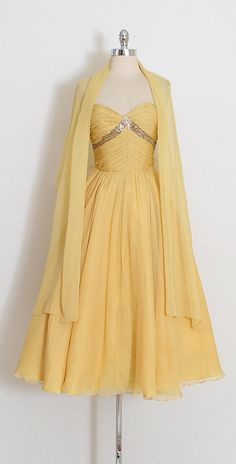 ➳ vintage 1950s dress with wrap  * golden yellow silk crepe chiffon * sequins flower accents * acetate lining * metal side zipper * strapless bodice with stays * matching wrap * by designer Frank Starr  condition   great - few very small holes and some inconspicuous spots on skirt that are lost on the folds. presents beautifully. priced adjusted accordingly.  fits like xs  length 42 bodice length 10 bust 32 waist 24  ➳ shop http://www.etsy.com/shop/millstreetvintage?ref&#...