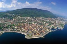 Neuchatel, Switzerland - If in Switzerland, make your camp in Neuchatel. Conveniently between both Geneva and Zurich, along with easy access to the Alps, Neuchatel is an adventure unto itself. Try the fondue and see about scuba diving in the pristine lake.
